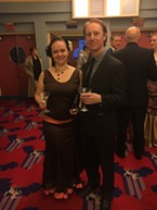 Meghan Liggett and Montel Vander Horck III with Martinis in the lobby.