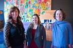 From left to right, Linda Prescott, Manger of Nutrition Education Programs and Service HCOE, Meagan Russin, Nutrition Educator, and Erin Derden-Little, the Farm to School Coordinator, pose in front of display cards about the Humboldt County Office of Educations Nutrition programs.