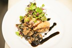 Wild mushroom empanada with chèvre, caramelized onion and baby greens in a blood orange vinaigrette.