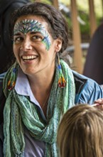 Missy Newkirk Fiedler, of Arcata, helped lead the face painting at the science expo at the D Street Neighborhood Center.