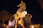 Demonstrators taped signs to the McKinley Statue at the Arcata Plaza.