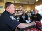 Capt. Steve Watson sits with Todd and Tanya Hudy at Vellutini Bakery.