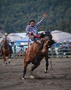 Joe Escalera, WSIRA competitor, riding saddle bronc.