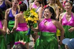 Maria Vanderhorst was presented with a floral bouquet as a gift after she led her last Samba da Alegria dance at the Samba Parade on Sunday at the North Country Fair.