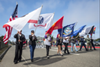 The Redwood Veterans Honor Guard marching in the 2016 Pride parade.