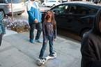 Sophia Phetsouphanh, 7, rolls down Fifth Street.