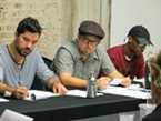 Playwright James McManus (center) and <i>Radioman</i>'s Assistant Director Daniel Penilla (left), listen intently during the play's second reading.