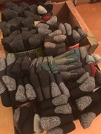 Boxes of socks awaiting donation.