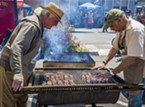 Staffing the barbecue racks filled with coho salmon kept Bruce Wayne (left) and Tim Needham busy.