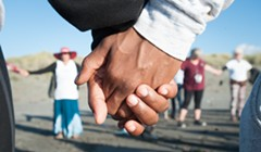 Dozens Gather to Remember Josiah Lawson at Beach Vigil