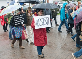 Don't Rain on Their Parade: Women's March Trudges Forward Despite Weather, Controversy