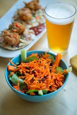 AMY KUMLER - Salad and shrimp tacos.