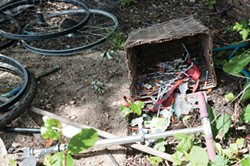 FILE - Needles discarded in a homeless camp.