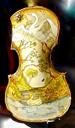Hand-painted violin is the work of Trisha Church.