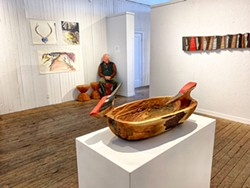 PHOTO BY WILLIAM PIERSON - Benson sitting among his pieces at Piante gallery.