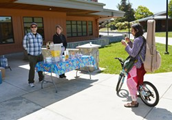 CR students enjoying refreshments in front of the resource center.