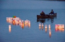 Volunteers retrieve lanterns at the conclusion of the 2012 Arcata Lantern Floating Ceremony. Photo - by Mark Larson.