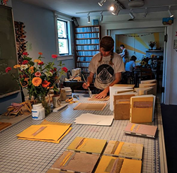 Daniel at work on handmade books - Uploaded by Katy Warner