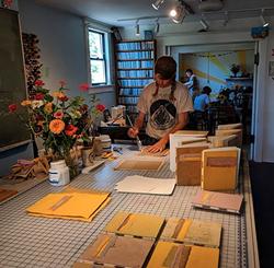 Daniel at work on handmade books - Uploaded by Katy Warner