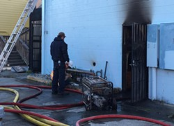 PHOTOS BY RYAN HUTSON - A generator reportedly caught fire behind Big Blue Cafe in Arcata on Oct. 27.