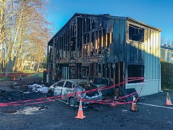 PHOTO BY THADEUS GREENSON - The burnt out remains of two apartments that suffered the brunt of a fatal fire that broke out before dawn Feb. 2 in a complex off Samoa Boulevard.