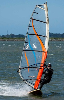 PHOTO BY MARK LARSON - Peter Portugal showed some strong windsurfing skills in the strong winds on Humboldt Bay.