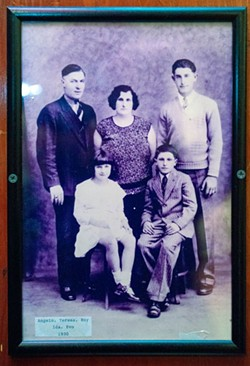 PHOTO BY MARK MCKENNA - A Fanucchi family portrait, with Ida at the bottom left, that hung for decades on the wall of Roy's Club in Eureka