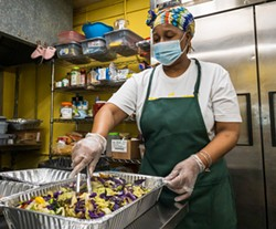 PHOTO BY ZACH LATHOURIS - Joanne Kerr mixing up vegetable sides in Jerk Kitchen's new digs.