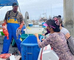 PHOTO BY ASHLEY HARRELL - Buying fish straight off the Oceana at Woodley Island Marina.