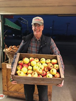 COURTESY OF CLENDENEN'S CIDER WORKS - Cliff Clendenen with his family's apples at Clendenen's Cider Works, which sends fruit to local schools.