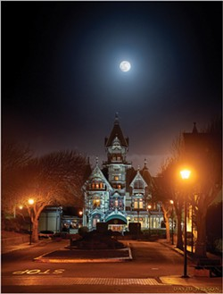 "PHOTO BY DAVID WILSON - The ""Snow Moon"" over Carson Mansion Feb. 8, 2020"