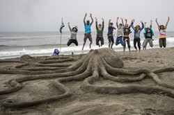 """PHOTO BY MARK LARSON - Team Northcoast Environmental Center celebrating the People's Choice 2019 Award for their sculpture, """"Lend a Hand, or Eight"""""""