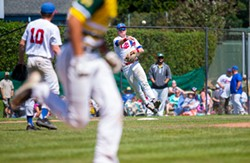 PHOTO BY THOMAS LAL - Usual Crabs pitcher Sean Prozell makes a play on a ground ball while playing third base to throw out a Fresno A's runner on Aug. 1 at Arcata Ballpark, while wrapping up a game where Crabs Manager Robin Guiver slotted multiple pitchers into the lineup to give players a chance to hit.