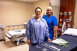 """PHOTO BY ANNE WERNIKOFF/CALMATTERS - In the past seven months, every COVID patient that Janet Stovall (left) and Candace Brim treated has died. """"We took care of about 65 COVID patients in Brawley and not a single one made it,"""" Stovall said. """"We coded one every night. ... Before (COVID), you could make a difference in someone's life. Now I will do anything for a patient, and it does not make a difference."""""""