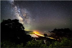 BY DAVID WILSON - A remote river valley and its skyline rest beneath the stars on the North Coast. The very core of our galaxy rests above the ridgeline. July 13, 2021.