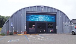 PHOTO BY GABRIELLE GOPINATH - The Neighborhood Alliance building with a Matt Beard seascape over the door.