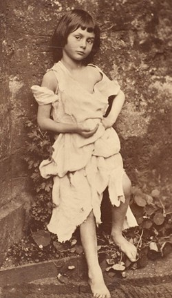 "METROPOLITAN MUSEUM OF ART, GILMAN COLLECTION. PUBLIC DOMAIN - Charles Dodgson (aka Lewis Carroll) took this collodion photograph of Alice Liddell, dressed as Tennyson's ""Beggar Maid,"" in her parents' Oxford garden in early June, 1857."