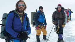 Climbers face the mountain led by Jake Gyllenhaal's majestic beard.
