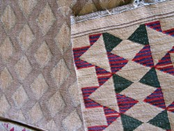 PHOTO BY LINDA STANSBERRY - Old and new: two native flat bags in Maret's collection, one twined before European contact and one after.