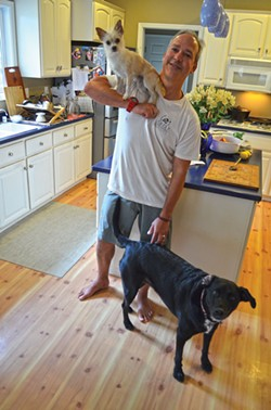 PHOTO BY GRANT SCOTT-GOFORTH - Gallegos and his dogs in his Eureka home earlier this year.