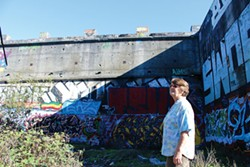 THADEUS GREENSON - Local homeless advocate Kathy Anderson stands in the graffiti-covered old concrete lumber kiln known as the Devil's Playground.