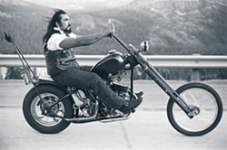 """Aguilar's """"Cousin Fred, Truckee, 1982"""" captures the pleasure of the open road."""