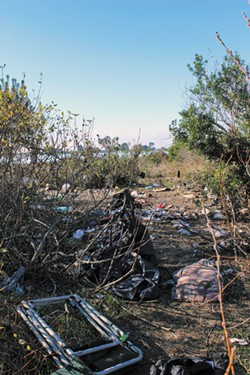 PHOTO BY THADEUS GREENSON - The debris left in the south end of the Palco Marsh after campers were pushed north.