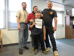 PHOTO BY LINDA STANSBERRY - Myles Moscato (center) holds the receipt for his application for a medical marijuana cultivation permit, the first in Humboldt County. He's joined by family members and Interim Director of Planning and Building Rob Wall (left).