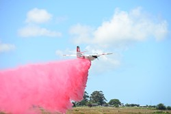 PHOTO BY MARK MCKENNA - A plane practices fire suppression techniques during a recent Cal Fire training.