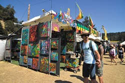 PHOTO BY ERICA BOTKIN - A booth of 3-D paintings on display at Reggae on the River.