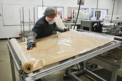 PHOTO COURTESY OF WHITE LABS - A worker at White Labs in San Diego prepares to cut a batch of yeast into smaller pieces for shipping.