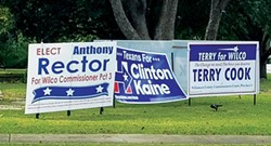 Signs fight for space on a lawn in Georgetown, Texas.