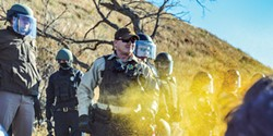 PHOTO BY ROB WILSON - Police use pepper spray on peaceful protesters on the bank of the Cannon Ball River in North Dakota.