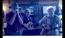 Frank Anderson on blues harp, Mark Jenny on guitar, Seabury Gould on guitar & piano, with all 3 musicians on vocals are the trio Legends of the Mind.